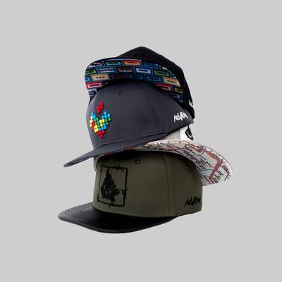 Different crazy Snapback Caps stacked on another